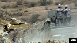Members of the Saudi border guard and army's armored personnel carrier (APC) patrol the Saudi-Yemeni border, in southwestern Saudi Arabia, April 9, 2015.