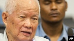 Khieu Samphan, former Khmer Rouge head of state, looks on before his final statements at the U.N.-backed war crimes tribunal in Phnom Penh, Cambodia, Thursday, Oct. 31, 2013.