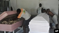 A carpenter makes new caskets for sale in New Kru in Monrovia, Liberia on October 22, 2014.