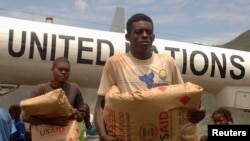 FILE - Donated food is unloaded in Haiti.