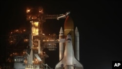 The space shuttle Discovery is prepared for launch at the Kennedy Space Center in Cape Canaveral, Florida, on Feb. 23, 2011.