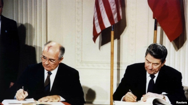 FILE - U.S. President Ronald Reagan (R) and Soviet President Mikhail Gorbachev sign the Intermediate-Range Nuclear Forces (INF) treaty at the White House in Washington, Dec. 8, 1987.