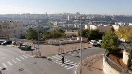 An ultra-Orthodox Jewish man walks in Ramat Shlomo, a religious Jewish settlement in an area of the occupied West Bank, in East Jerusalem, claimed by both Israel and Palestinians, December 18, 2012.