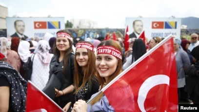 FILE - Supporters of Turkish President Recep Tayyip Erdogan gather before a pre-election rally in Sarajevo, Bosnia and Herzegovina, May 20, 2018.