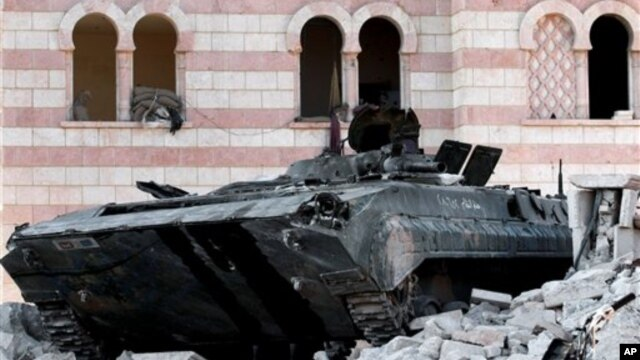 A damaged Syrian military tank is seen at the border town of Azaz, about 20 miles north of Aleppo, Syria, July 24, 2012.