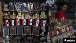 A shopkeeper waits for tourists at a souvenir shop in old Cairo, Oct. 29, 2013.