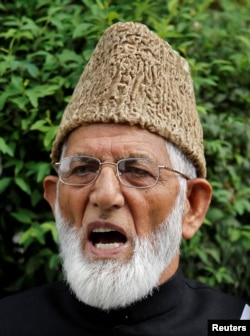 FILE - Syed Ali Shah Geelani, chairman of the hardliner faction of Kashmir's Hurriyat (Freedom) Conference, speaks during a news conference in Srinagar, August 7, 2010.