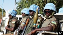 The blue helmets of UN peacekeepers distinguish them from the many armed groups in Darfur.