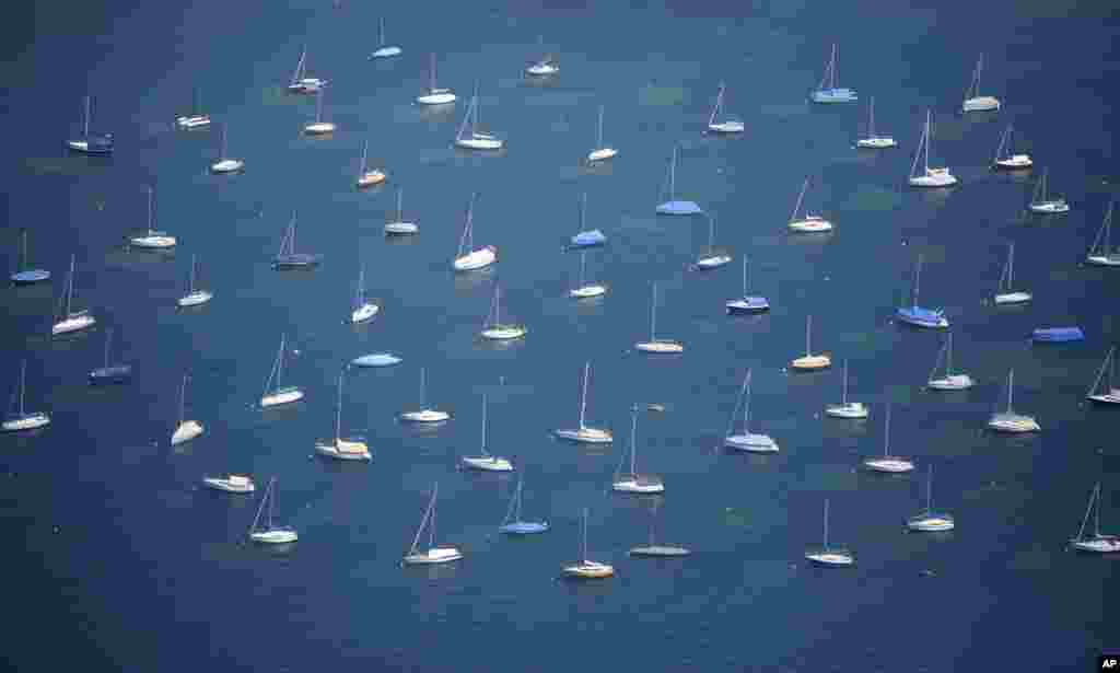 Sailing boats anchor on lake Bodensee in Konstanz, Germany.