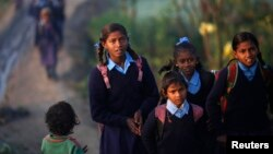 More than 80 schoolgirls in northern India go on hunger strike, May 18, 2017, to protest harassment they faced on the way to school, drawing attention to the dangerous commutes.