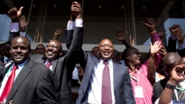 Kenya's presidential candidate Uhuru Kenyatta (C) and his running mate William Ruto (2nd L) celebrate winning the presidential election with supporters after the official result was released in Nairobi, March 9, 2013.