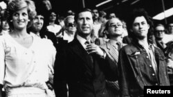 Diana, Princess of Wales, and Prince Charles stand with Bob Geldof in the Royal Box at Wembley Stadium at the start of the Live Aid charity concert in London, July 13, 1985.