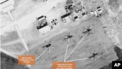 Satellite image of helicopters at the Sudanese airbase at Kidugli.