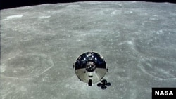 The Apollo 10 command module is seen orbiting the moon during its 1969 mission.