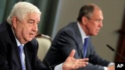 Ο Υπουργός Εξωτερικών της Συρίας, Ουαλίντ Μοαλέμ και ο ρώσος ομόλογος του Σεργκέι Λαβρόφ