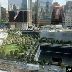View of two giant memorial pools created in the footprints where the twin towers of the World Trade Center once stood, New York, September 11, 2011.