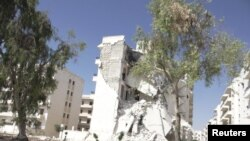 Buildings damaged by what activists said was shelling by forces loyal to Syria's President Bashar al-Assad are seen in Aleppo September 23, 2012. Picture taken September 23, 2012. REUTERS/Shaam News Network/Handout (SYRIA - Tags: POLITICS CIVIL UNREST) FO