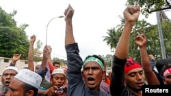 Rohingya Muslims living in Malaysia protest the treatment of Myanmar's Rohingya Muslims near the Myanmar Embassy in Kuala Lumpur, Malaysia, Sept. 8, 2017.