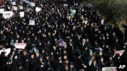 Iranian protesters chant slogans at a rally in Tehran, Iran, Dec. 30, 2017. Iranian hard-liners rallied Saturday to support the country's supreme leader and clerically overseen government as spontaneous protests sparked by anger over the country's ailing economy.