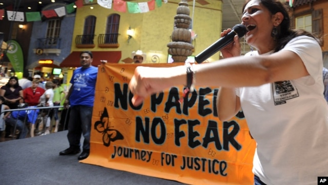 "Georgia Latino Alliance for Human Rights member Adelina Nicholls, of Mexico, joins members of a cross-country group of undocumented immigrants participating in a ""No Papers No Fear"" event at Fiesta Mall in Atlanta, August 25, 2012."