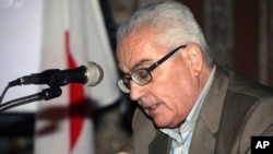 In this undated photo released Aug. 18, 2015 by the Syrian official news agency SANA, one of Syria's most prominent antiquities scholars, Khaled al-Asaad, speaks in Syria.
