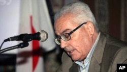FILE - One of Syria's most prominent antiquities scholars, Khaled al-Asaad, speaks in Syria.