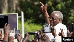 FILE - Uganda's former Prime Minister Amama Mbabazi, now a presidential candidate, speaks to the media at a gathering in Jinja town in eastern Uganda, Sept. 10, 2015.