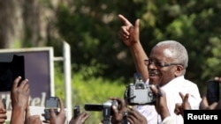 FILE - Uganda's former Prime Minister Amama Mbabazi, now a presidential candidate, speaks to the media at a gathering in Jinja town in eastern Uganda, Sept. 10, 2015. Mbabazi has accused the electoral commission of being one-sided and partisan.