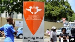 Students queue outside the University of Johannesburg to register for this year's studies, January 10, 2012.