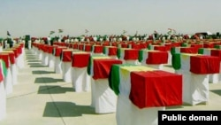 Coffins containing remains of those killed in the brutal al-Anfal campaign.