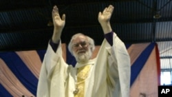 Anglican spiritual leader Archbishop Rowan Williams of Canterbury greets the congregants gathered at the City Sports Center in Harare on October 9, 2011.