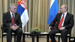 Russian President Vladimir Putin, right, and Serbian President Tomislav Nikolic in Moscow, Saturday, May 26, 2012.