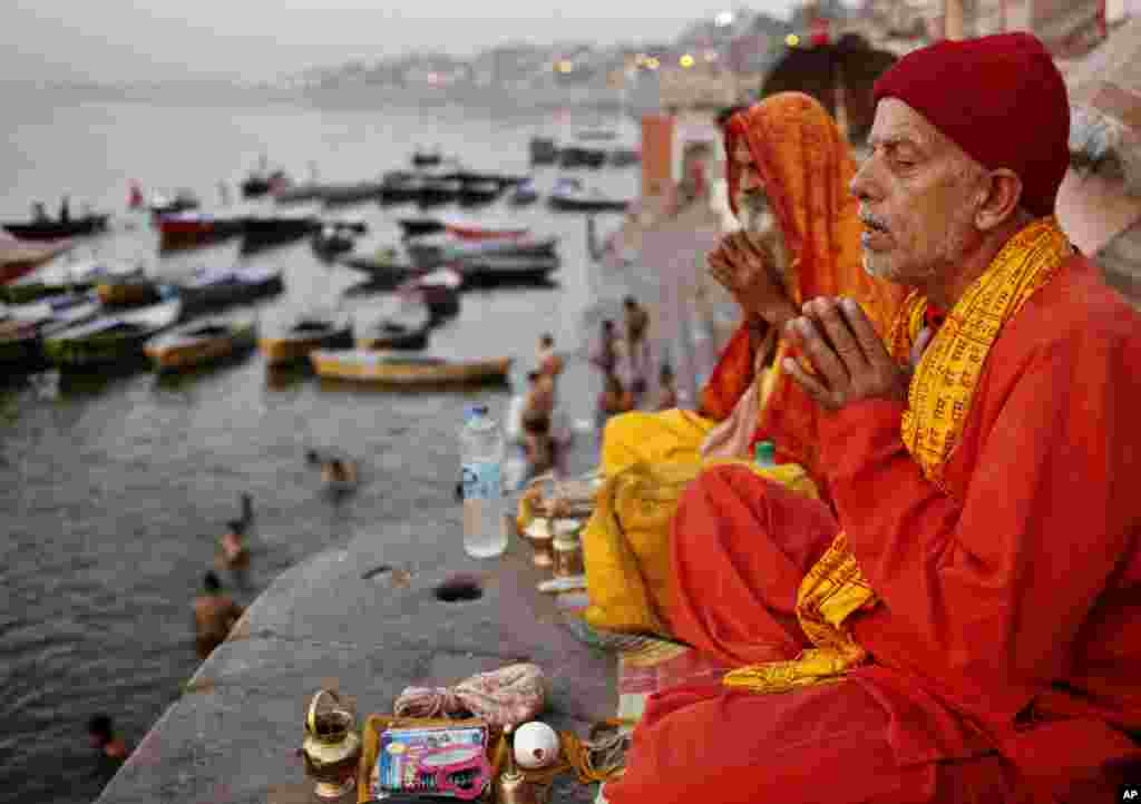Hindu devotees offer prayers in the morning on the banks of the holy River Ganges in Varanasi, India. Varanasi is among the world's oldest cities.