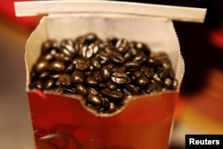 FILE - Coffee beans are seen in a bag at a branch of Nairobi Java House in Nairobi.
