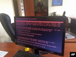 FILE - A computer screen cyberattack warning notice reportedly holding computer files to ransom, as part of a massive international cyberattack, at an office in Kyiv, Ukraine, June 27, 2017.