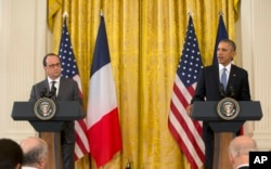 President Barack Obama and French President Francois Hollande participate in a news conference in the East Room of the White House in Washington, Tuesday, Nov. 24, 2015.