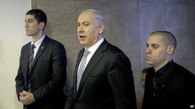 Israel's Prime Minister Benjamin Netanyahu, center, arrives at the weekly cabinet meeting in Jerusalem, February 5, 2012.