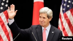 U.S. Secretary of State John Kerry waves after his lecture to students at Tokyo Institute of Technology in Tokyo April 15, 2013.