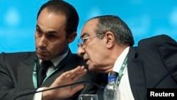 Gamal Mubarak, left, son of former Egyptian leader Hosni Mubarak, with Zakaria Azmy, Cairo, Oct. 31, 2009.