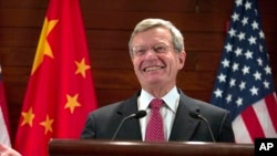 FILE - U.S. Ambassador to China Max Baucus briefs journalists at the U.S. embassy in Beijing, China, Mar. 18, 2014.