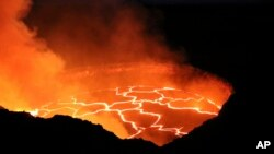 In this photo provided by the U.S. Geological Survey, the lava lake atop Kilauea volcano erupts on Hawaii's Big Island, Sept. 28, 2016.