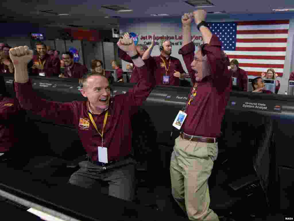 "Mars InSight team members Kris Bruvold, left, and Sandy Krasner react after receiving confirmation that the Mars InSight lander successfully touched down on the surface of Mars, Nov. 26, 2018 inside the Mission Support Area at NASA's Jet Propulsion Laboratory in Pasadena, California. InSight, short for Interior Exploration using Seismic Investigations, Geodesy and Heat Transport, is a Mars lander designed to study the ""inner space"" of Mars: its crust, mantle, and core."