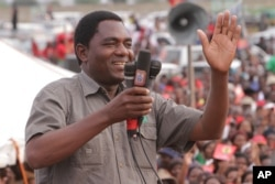 FILE - In this January, 2015 photo, Hakainde Hichilema, of the Zambia opposition United Party for National Development addresses an election rally in Lusaka, Zambia.