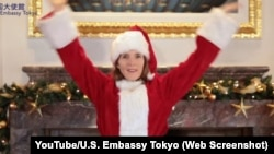 "U.S. Ambassador to Japan Caroline Kennedy dressed up as Santa Clause for the embassy's version of the popular ""koi"" dance."
