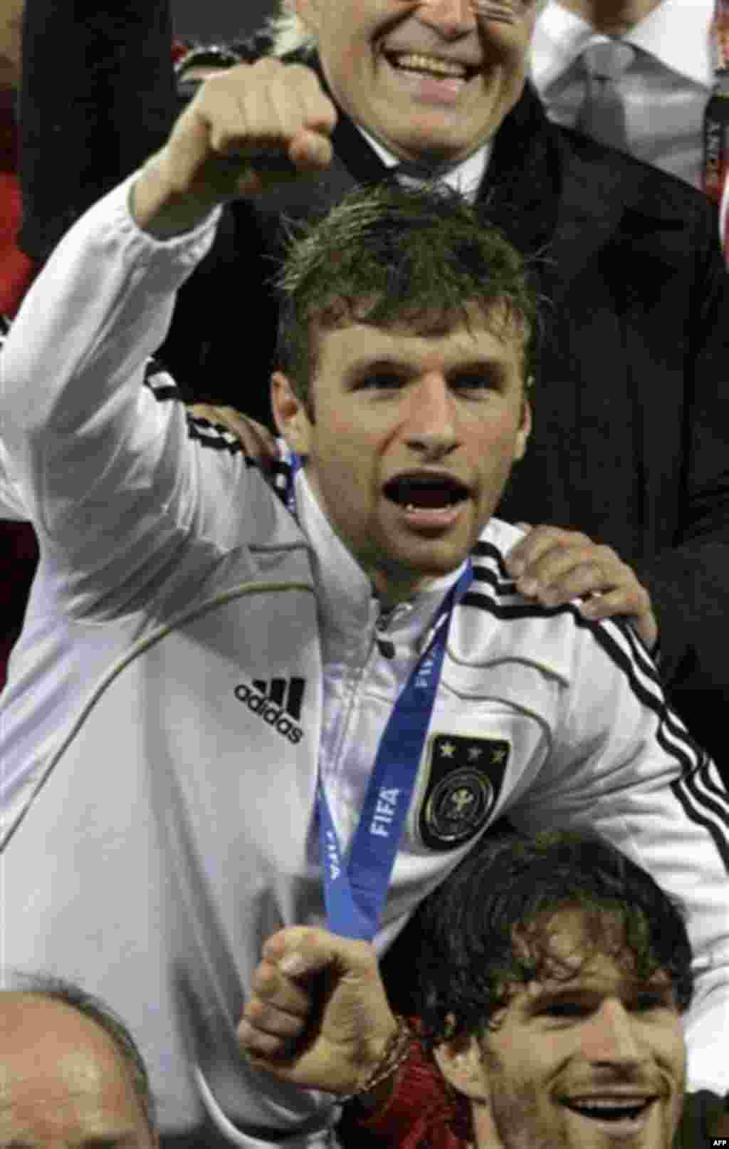 Germany's Thomas Mueller celebrates his side's 3-2 win after the World Cup third-place soccer match between Germany and Uruguay at Nelson Mandela Bay Stadium in Port Elizabeth, South Africa, Saturday, July 10, 2010. (AP Photo/Gero Breloer)