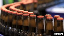 Beer bottles are picturedat the processing line of the newly inauguratd Dashen brewery plant in Debre Birhan town northeast of Ethiopia's capital Addis Ababa Nov. 15, 2015.