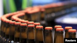 Beer bottles are pictured at the processing line of the newly inaugurated Dashen brewery plant in Debre Birhan town northeast of Ethiopia's capital Addis Ababa Nov. 15, 2015.