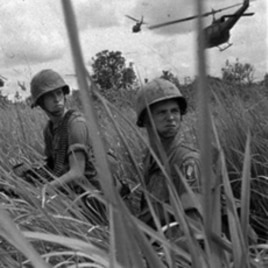 Two U.S. paratroopers seen during landing operations in Vietnam, north of Saigon, 1965.