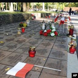 Candles, flowers and Polish flags mark gravestones of Polish officers killed 70 years ago by Soviet secret police in the Katyn massacre, during commemorating events in Kharkiv, Ukraine (File)