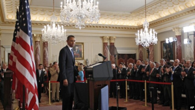 U.S. President Barack Obama receives a standing ovation after a speech about the United States' policy on the Middle East and North Africa at the State Department in Washington, May 19, 2011.